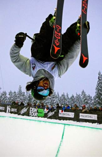 A skier gets inverted on a trick during the Dew Tour men's ski superpipe competition at Breckenridge Ski Resort Saturday.