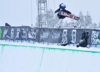China's Jiayu Liu tweaks a lofty 720 Indy during her first run at the women's Dew Tour snowboard halfpipe final on Dec. 12. Liu took first place with a score of 91.00.