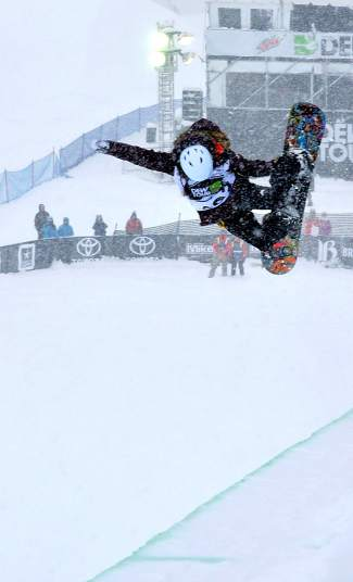 China's Jiayu Liu ends with a tuck-knee alley oop during her first run at the women's Dew Tour snowboard halfpipe final on Dec. 12. Liu took first place with a score of 91.00.