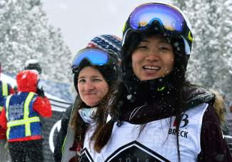 China's Jiayu Liu (right) watches the results screen with Kelly Clark (left) at the base of the Breckenridge halfpipe after her run in the women's Dew Tour snowboard final. Liu took second ahead of Chloe Kim and Kelly Clark.