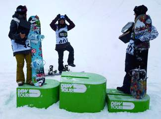 China's Jiayu Liu (center) takes a victory lap through the halfpipe for the medal presentation after the women's Dew Tour snowboard. Liu took first, followed by Chloe Kim and Kelly Clark.