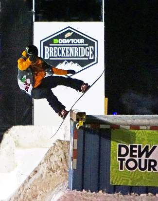A snowboarder competes in the Dew Tour streetstyle competition on Washington Avenue in Breckenridge Friday.
