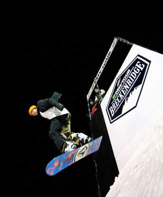 A snowboarder drops in for a run at the Dew Tour streetstyle course on Washington Avenue in downtown Breckenridge on Dec. 11.