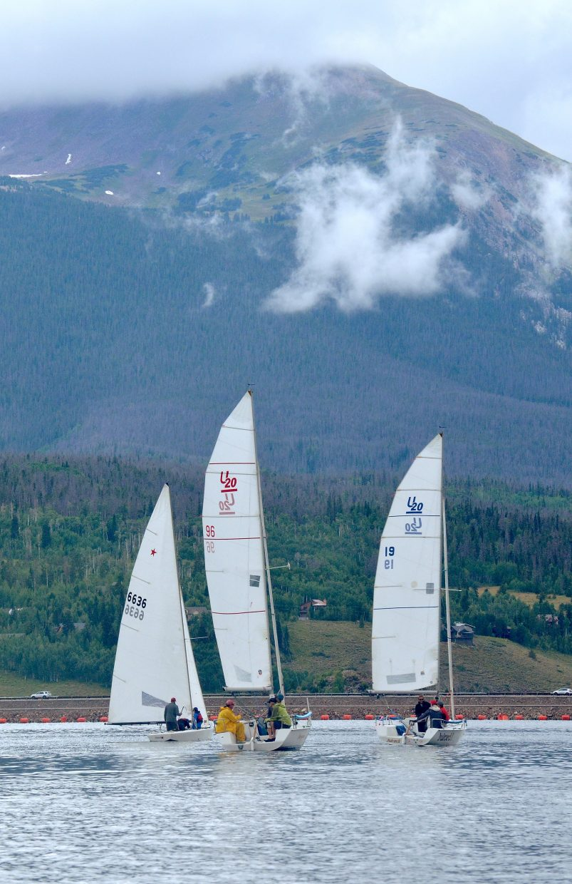A trio of sailboats waits patiently for the wind to billow during the first day of racing at the Dillon Open Regatta on Lake Dillon Aug. 6. The wind never did pick up, but the sun came out and crews on both boats had plenty of time to sunbathe.