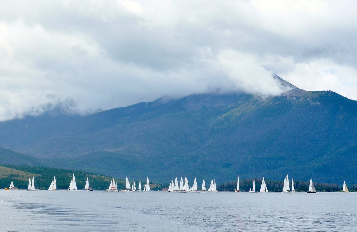 More than 40 sailboats wait for wind on the first day of racing at the Dillon Open Regatta with a clouded Peak One in the background on Aug. 6. The day started under clouds and ended under the sun, but the wind never arrived.
