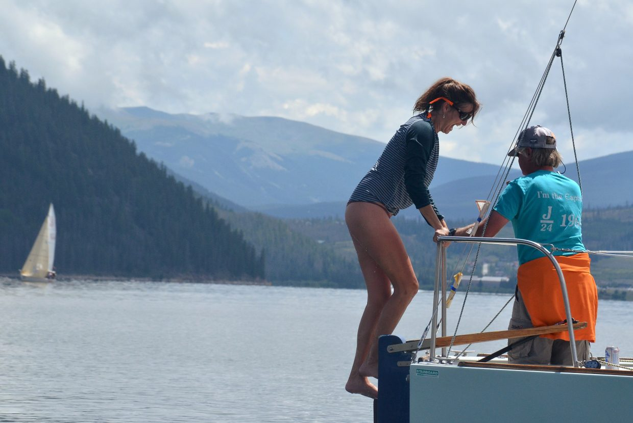 A crew member gets back in her sailboat after taking a dip in Lake Dillon while waiting for the wind to pick up at the 2016 Dillon Open Regatta. It never did, and all races were postponed until today.