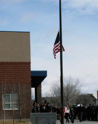 The U.S. flag flies at half-staff  Dec. 14 at Rifle High School for the funeral of 2003 graduate Will DuBois, an F-16 pilot killed in a crash in Jordan.