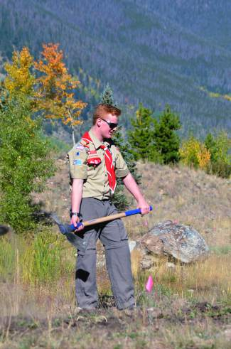 Chris Rohlf looks pleased while examining progress on a new Flight For Life trail that he is performing as a service project to become an Eagle Scout.