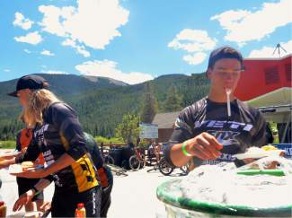Enduro World Series champ Richie Rude (right) grabs lunch between stages at the 2016 Keystone Big Mountain Enduro on July 9. The annual event drew more than 300 pro and amateur riders to the Keystone Bike Park for six stages of downhill riding on berms, drops and boulders.