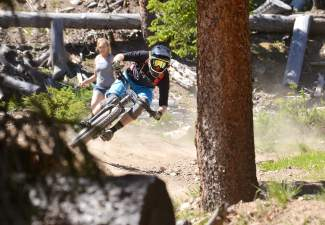 Pro rider Flynn George whips through a berm on Stage Two of the 2016 Keystone Big Mountain Enduro on July 9. The annual event drew more than 300 pro and amateur riders to the Keystone Bike Park for six stages of downhill riding on berms, drops and boulders.