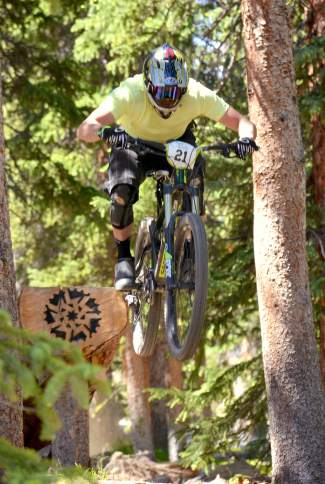 Vail-area enduro rider and World Cup ski-cross racer Chris Del Bosco launches off a log ramp during Stage Two of the 2016 Keystone Big Mountain Enduro on July 9. The annual event drew more than 300 pro and amateur riders to the Keystone Bike Park for six stages of downhill riding on berms, drops and boulders.