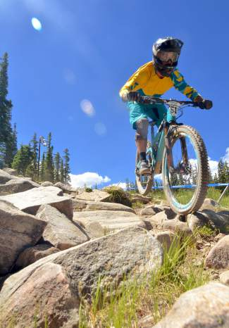 Enduro pro Shawn Neer picks through the boulder field on Cowboy Up during the 2016 Keystone Big Mountain Enduro on July 9. The annual event drew more than 300 pro and amateur riders to the Keystone Bike Park for six stages of downhill riding on berms, drops and boulders.