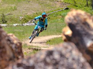 A rider rounds a switchback halfway through Stage Two of the 2016 Keystone Big Mountain Enduro on July 9. The annual event drew more than 300 pro and amateur riders to the Keystone Bike Park for six stages of downhill riding on berms, drops and boulders.