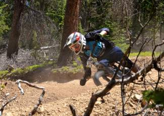 A rider rounds a berm on the trail during Stage One of the 2016 Keystone Big Mountain Enduro on July 9. The annual event drew more than 300 pro and amateur riders to the Keystone Bike Park for six stages of downhill riding on berms, drops and boulders.