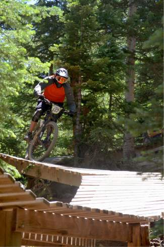 A rider winds through the log bridges low on Sanitarium trail during the 2016 Keystone Big Mountain Enduro on July 9. The annual event drew more than 300 pro and amateur riders to the Keystone Bike Park for six stages of downhill riding on berms, drops and boulders.
