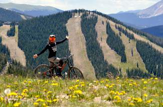 Enduro pro Anne Gaylean takes a break on top of Dercum Mountain at Keystone between practice runs the day before the 2016 Keystone Big Mountain Enduro July 9-10. The Idaho native found professional downhilling just a year before tackling a six-year Ph.D. program for biochemical engineering.