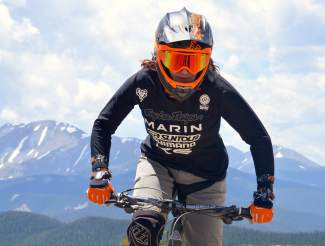 Enduro pro Anne Gaylean rides at Keystone Mountain before the first day of racing at the 2016 Keystone Big Mountain Enduro race July 9. Gaylean juggled a Ph.D. program and professional downhill racing for six years while living on the East Coast. She recently graduated and moved to Colorado, right around the same time she switched from DH to enduro.