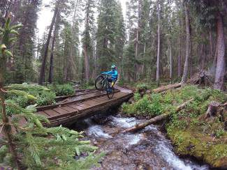 New Zealand's Carl Jones rides a wheelie over a wood bridge in Breckenridge a few days before competing in the 2016 Keystone Big Mountain Enduro. The 29-year-old former mountain bike XC pro is making his North American enduro debut at the BME series, beginning today at 10 a.m.