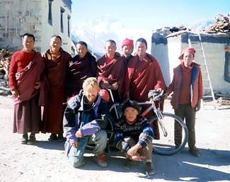 Summit resident Brian Brill with monks at a Tibetan monastary near the north Mount Everest base camp in 1998.