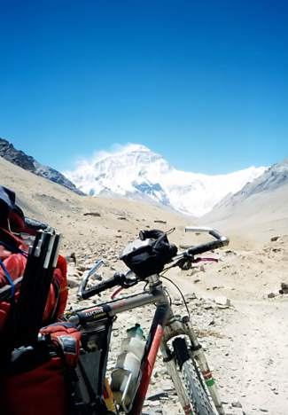 Brian Brill pauses with his bike during a 1998 mountain bike trek to north Mount Everest base camp, accessed through military checkpoints in Tibet.