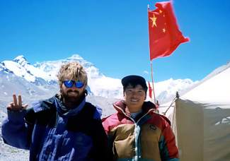 Brian Brill with a Chinese soldier at a military checkpoint outside of north Mount Everest base camp. The checkpoint was the highest Brill was allowed to travel on his 1998 mountain bike ride.