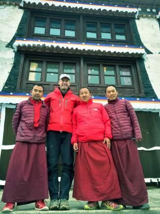 Patrick Sweeney with Tashi Lama, left, and several other Buddhist monks. Sweeney is now helping the same monks who helped him on his Mount Everest journey through a nonprofit campaign, 1000 Tents in 100 Days.