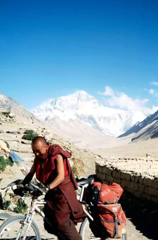 A Tibetan monk rides on Brian Brill's mountain bike for the first time during the Summit local's 1998 ride to north Mount Everest base camp. Like the Nepali monks encountered by Patrick Sweeney, another local adventurer who rode to the south base camp, Brill says the monks had never seen a bike until he arrived.
