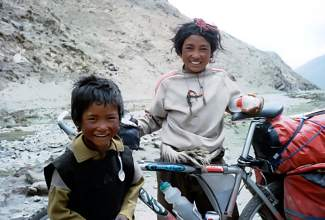 Tibetan children play on Brian Brill's bike during the Summit local's 1998 ride to the north Mount Everest base camp.