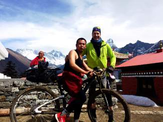 Patrick Sweeney shows Tashi Lama his mountain bike during a recent mountain bike trip to the south Mount Everest base camp. Most people Sweeney encountered on the trip had never seen a bicycle before. Sweeney maintains that he is the first modern rider to bike the Nepali route to base camp, although several others (including Summit locals) have made the ride to the Tibetan base camp in the past few decades.