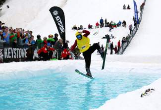 A pond skimmer starts to lose his balance during Keystone's closing day Slush Cup in 2015. The resort closed for the 2015-16 season on April 10, two weeks before Breckenridge and Copper are closing.