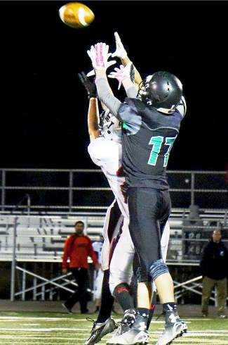 Eagle Valley's Mathew Sanchez intercepts a pass intended for Summit's Vale Hildebrand (17) late in the second half of the Tigers 0-10 loss on Oct. 2.