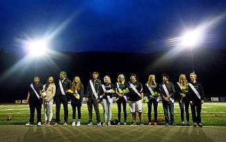 Homecoming court students are introduced during halftime of the Summit-Eagle Valley football game on Oct. 2.