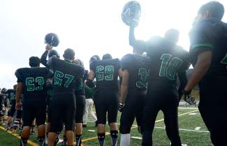 The Tigers before the home opener against the Skyview Wolverines on Sept. 4. Summit HS won 34-7, the team's best performance of the season so far.