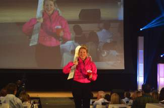 Breckenridge councilwoman Elisabeth Lawrence carried a pair of skis down the runway.