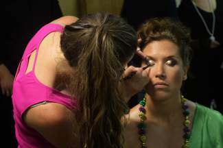 Stylists with Majestic Mountain Beauty applied makeup to the models backstage.