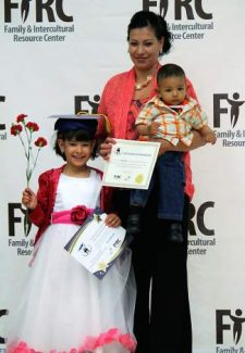 Iris, Jannette and Eric Garcia de Alderete celebrate the kindergarteners graduation from the Family and Intercultural Resource Center's home visitation program Thursday, Aug. 7, 2014.