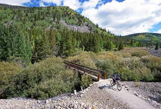 A racer crosses French Creek during the 2015 Fall Classic mountain bike race in Breckenridge. The ride has changed little since its early days in the '80s during the first big mountain-biking boom.