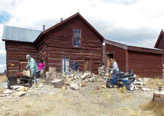 The Summit Huts volunteer crew working together in front of Section House during a recent volunteer day.