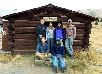 Mike Zobbe (bottom left) with the log-splitting crew in front of Ken's Cabin.