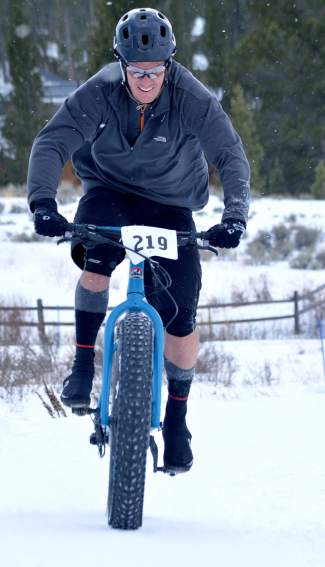 A rider barrels up a snowy hill during the inaugural Fat Bike Open at Gold Run Nordic Center on Dec. 5. The race drew nearly 70 riders from across the state, including several pros.