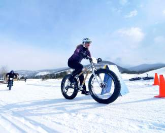 Summit local Shawna Henderson rounds a corner on a Boo Bicycles demo fat bike at the inaugural Fat Bike Open at Gold Run Nordic Center in Breckenridge earlier this season. Boo Bicycles co-owner Nick Frey will ride the exact same demo setup in the Fat Bike Eliminator, an invite-only race through downtown Breck at 2:30 p.m. on Jan. 14.