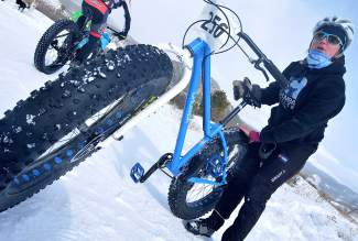 Summit County native Kate Zander preps her new fat-bike rig before the inaugural Fat Bike Open at Gold Run Nordic Center on Dec. 5. Zander, who races in the summer Summit Mountain Challenge series, is among dozens of local mountain bikers who have taken up fat biking.