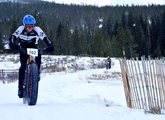 Young Landen Turner of Conifer, winner of the junior boys division, pedals up a slippery hill at the inaugural Fat Bike Open at Gold Run Nordic Center on Dec. 5. The race drew nearly 70 riders from across the state, including several pros.