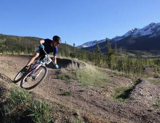 A rider rounds a bend on the Summit Mountain Challenge Frisco Peninsula race course last season. The peninsula is home to nearly a dozen trails, including the Frisco Adventure Park course.