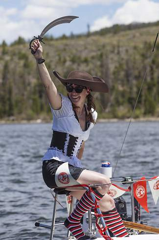 A lady pirate shows steel during the New Belgium Timberline Cruiser Regatta out of the Frisco Bay Marina in 2014. The race returns this year with costumes, prizes and live music on June 25.