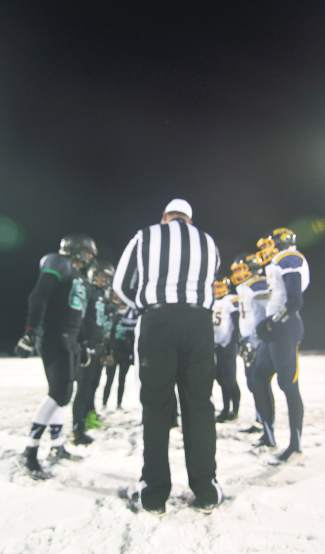 Captains meet for the coin toss before the Summit vs. Rifle home closer on Nov. 6. The Tigers lost, 6-55.