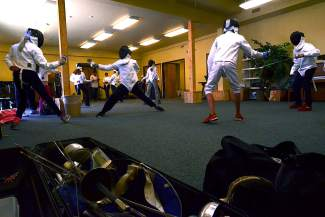 The Peak School fencing class practices in full regalia on an October afternoon. This is the first year the school has offered the class as an elective.