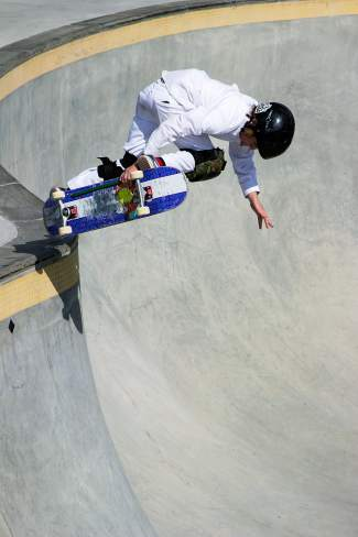Jack Coyne stalls on the concrete lip of the brand-new big bowl at the Breckenridge skatepark during the Chris Ferris Memorial Skate Competition on Aug. 29. The town dedicated the bowl to Ferris, the former owner of Big Hit skateshop.
