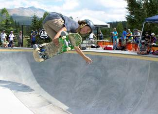 Tairoa Tait throws a melon grab in the big bowl at Breckenridge skatepark at the Chris Ferris Memorial Skate Competition on Aug. 29.