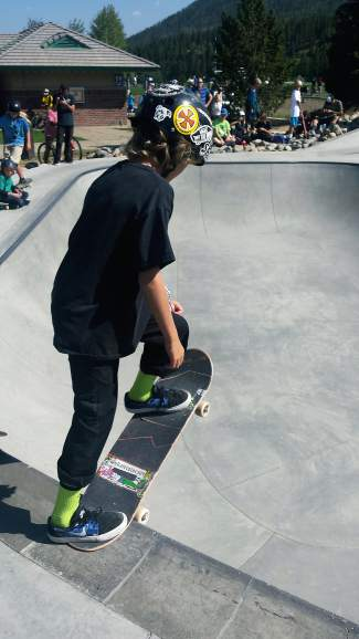 A grom gets ready to drop into the bowl at Breckenridge skatepark during the Chris Ferris Memorial Skate Competition on Aug. 29.